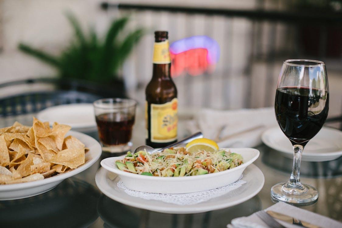 Salad and Half-filled Wine Glass