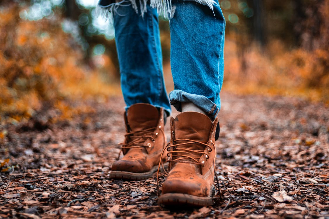 Shallow Focus Photography Of Blue Jeans And Brown Boots