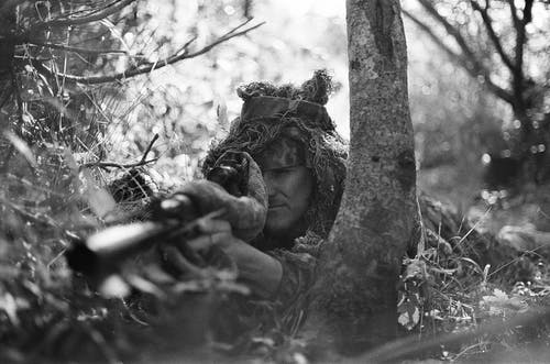 Grayscale Photography of Sniper