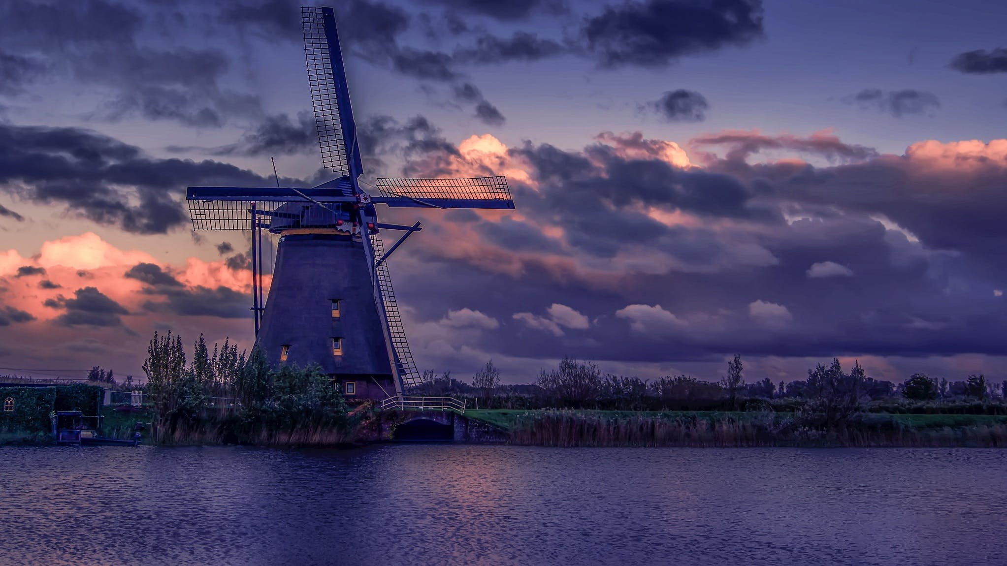 Windmill Near River during Sunset
