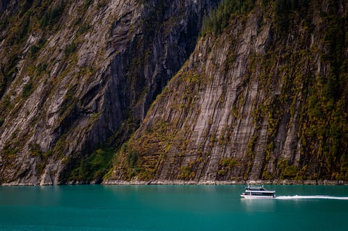 Sailboat on Ocean Near Mountain