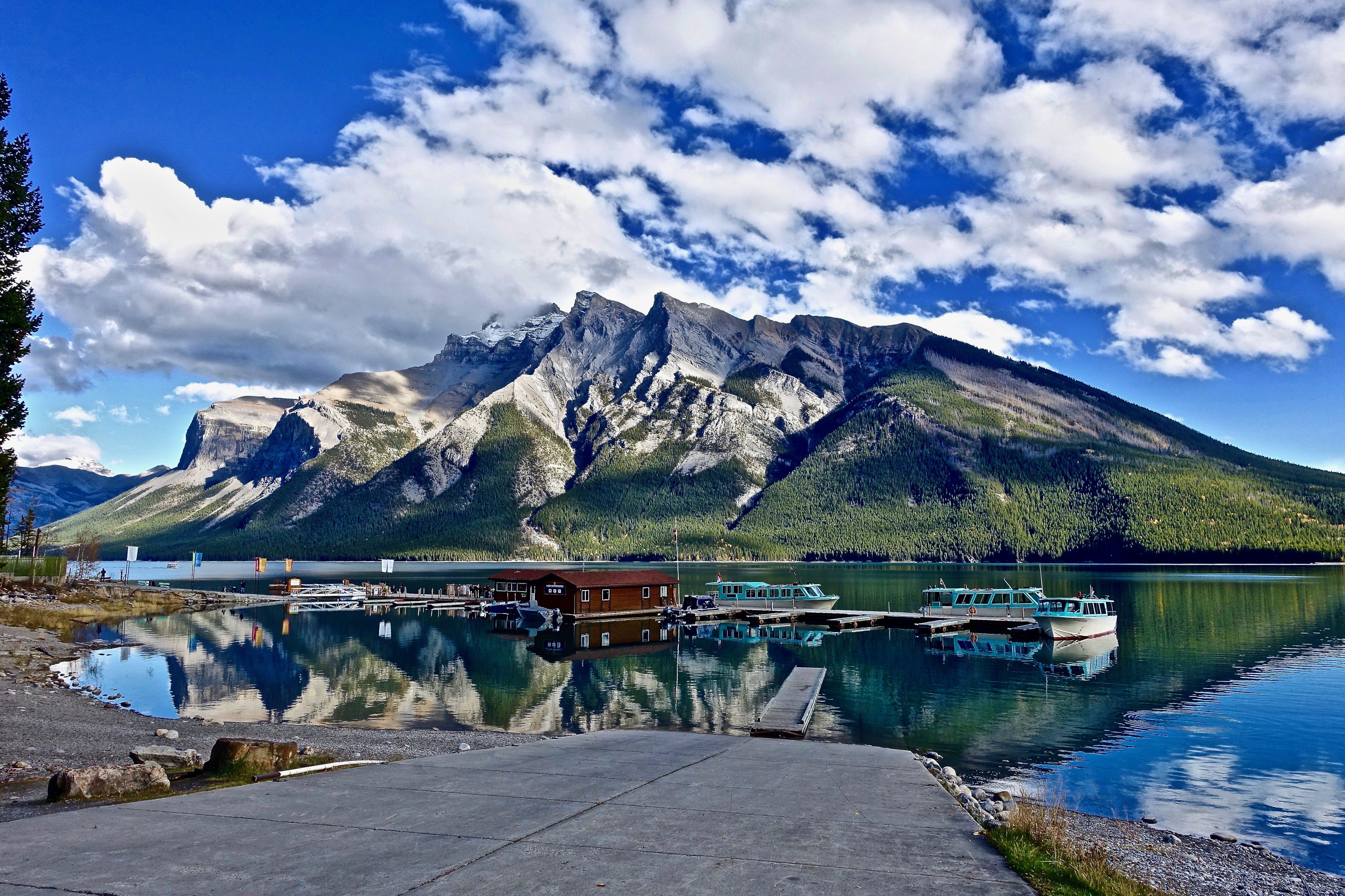 Body of Water Beside Mountain Alps