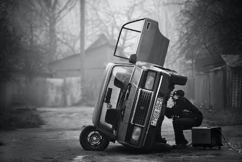 Foto profissional grátis de atividade, automóvel, consertar, homem