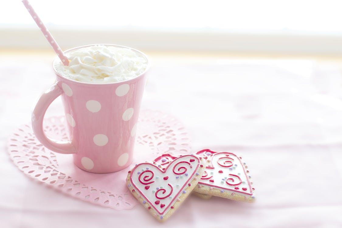 Pink and White Ceramic Mug on Table