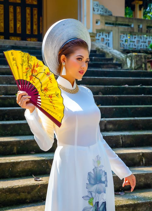 Woman In White Dress Holding Hand Fan