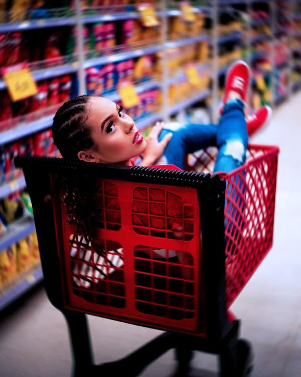 Woman In Red Grocery Cart