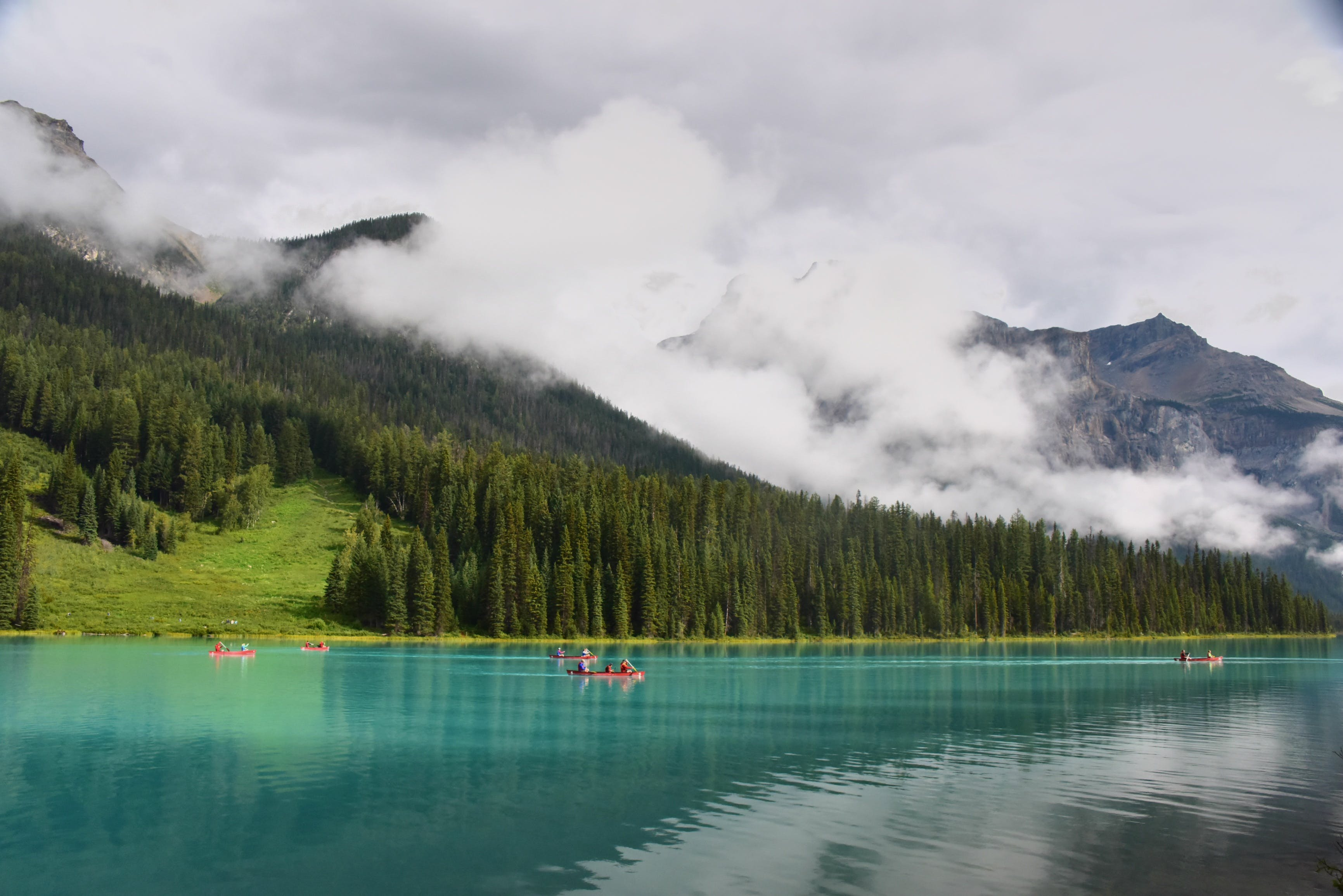 People Riding Boat on Lake