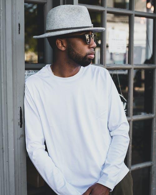Photo Of Man Wearing Sun Hat