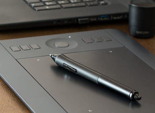 Pen on Gray E-book Reader