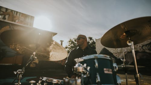 Shallow Focus Photo of Man Playing Drums