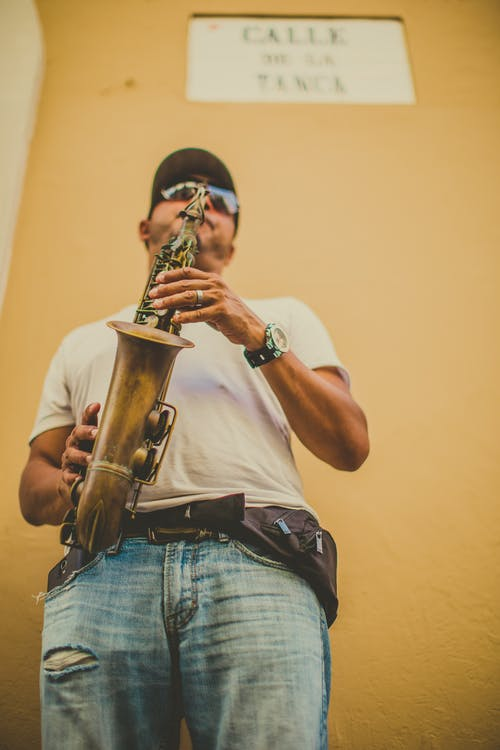 Shallow Focus Photo Of Man Playing Saxophone