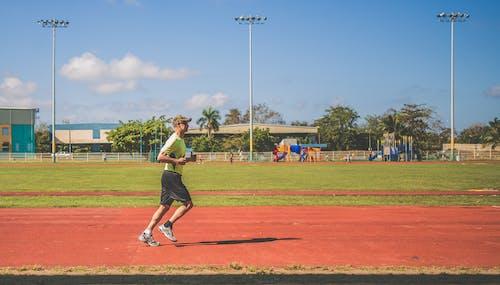 Man Running On A Field