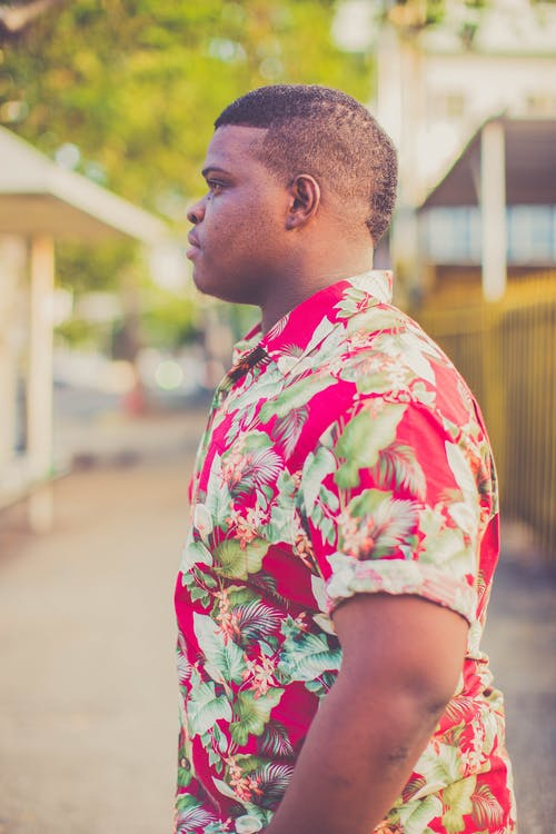 Side-view Photo of Man Wearing Pink, White, and Green Floral Dress Shirt