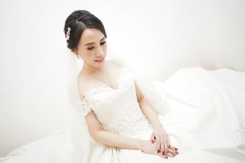 Woman Wearing White Bridal Gown