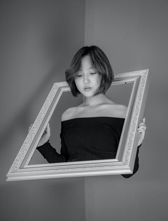 Photo Of Woman Holding Frame
