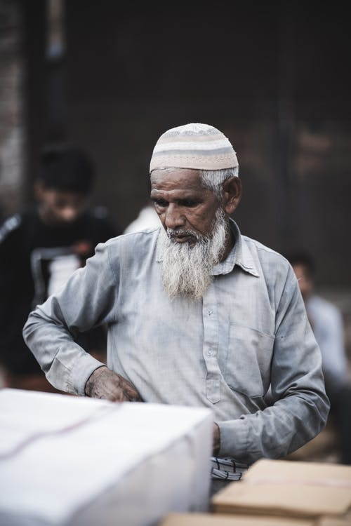 Photo Of Old Man Wearing Traditional Headwear