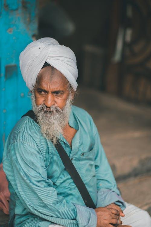 Photo Of Old Man Wearing Traditional Headwear