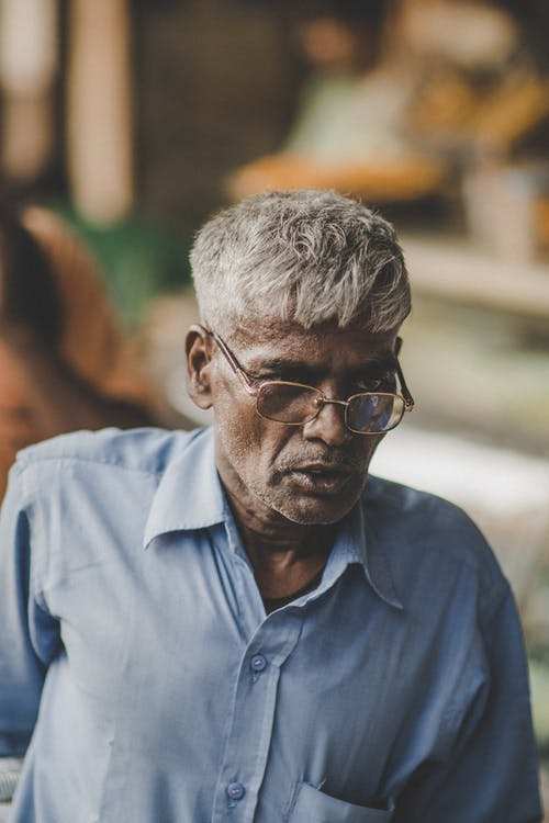 Photo Of Old Man Wearing Eyeglasses