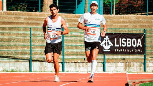 Two Men Running On Track
