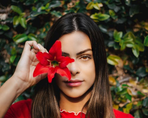 Woman Holding Red Flower