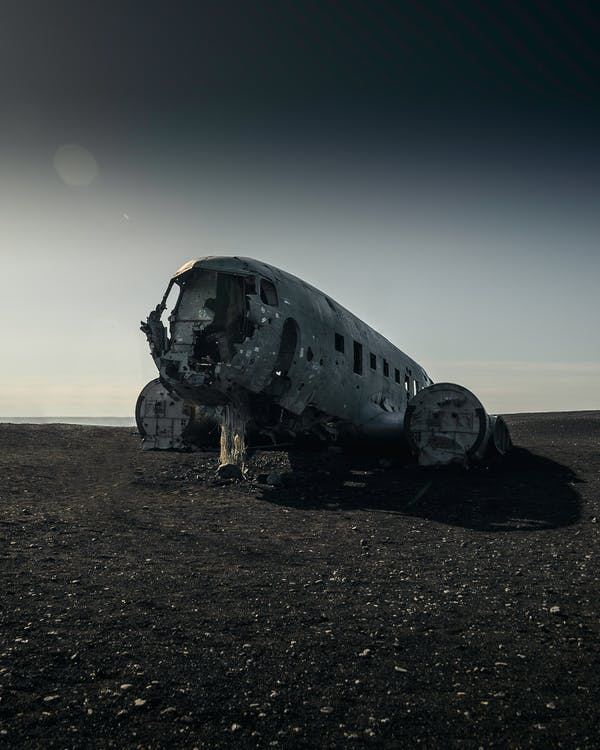 Wrecked Gray Airliner on Ground