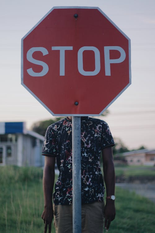 Person Behind Stop Signage