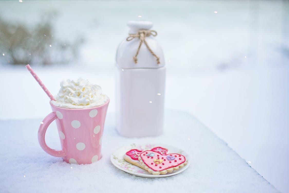 Pink and White Polkadot Ceramic Mug on the Table