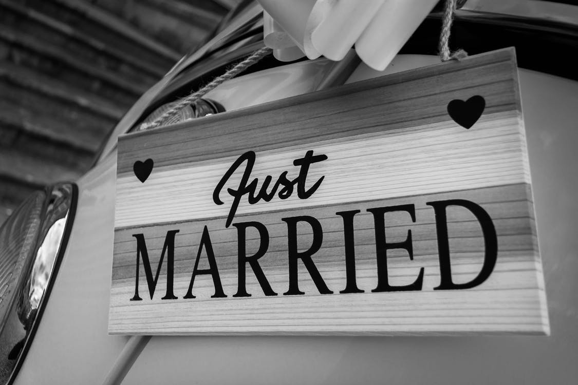 Grayscale Photo of Just Married Signage