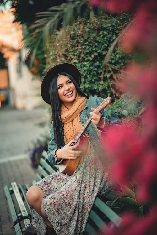 Photo Of Woman Playing Guitar