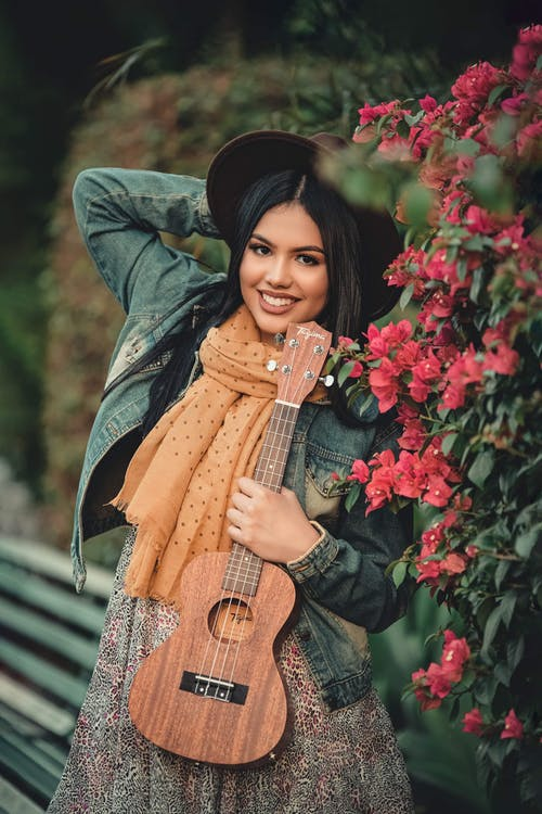 Photo Of Woman Holding Guitar