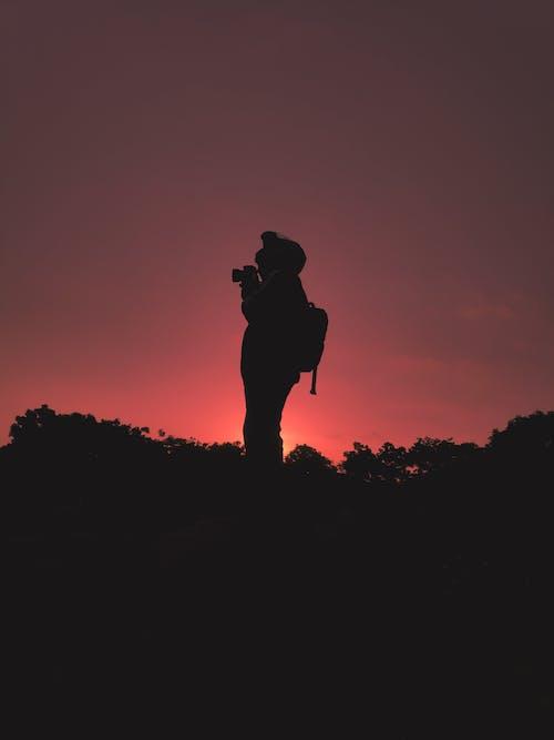 Gratis stockfoto met achtergrondlicht, avontuur, dageraad, omtrek