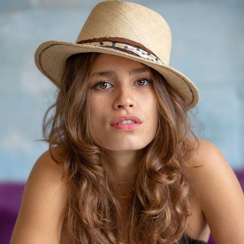 Close-Up Photo Of Woman Wearing Hat