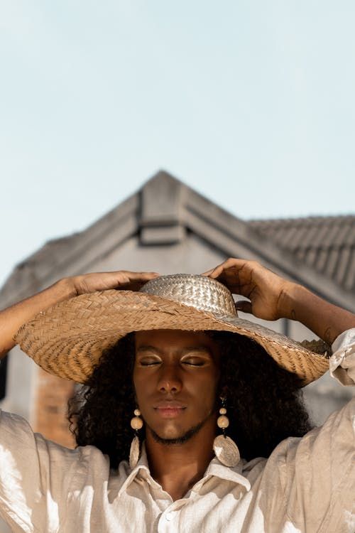 Person Wearing A Straw Hat