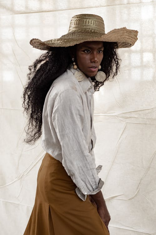 Stylish black model in straw hat