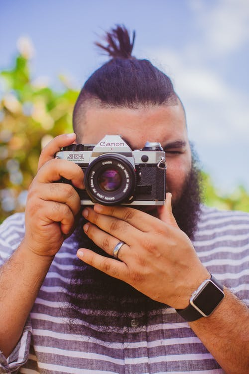 Photo Of Man Holding Camera