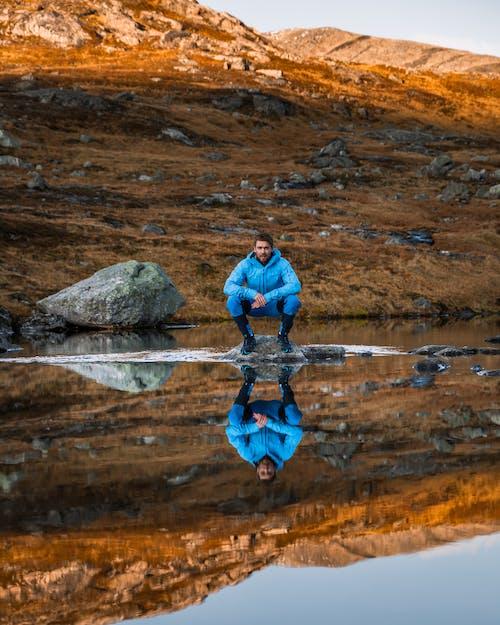 Photo of Man Wearing Blue Jacket