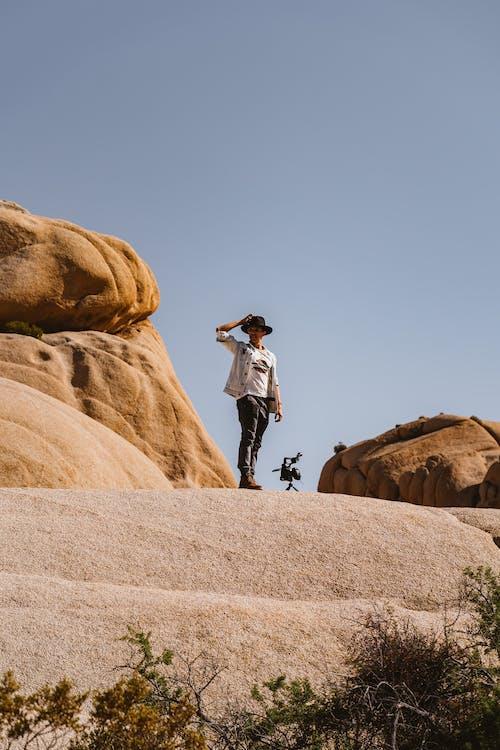 Man Standing Near Rocks