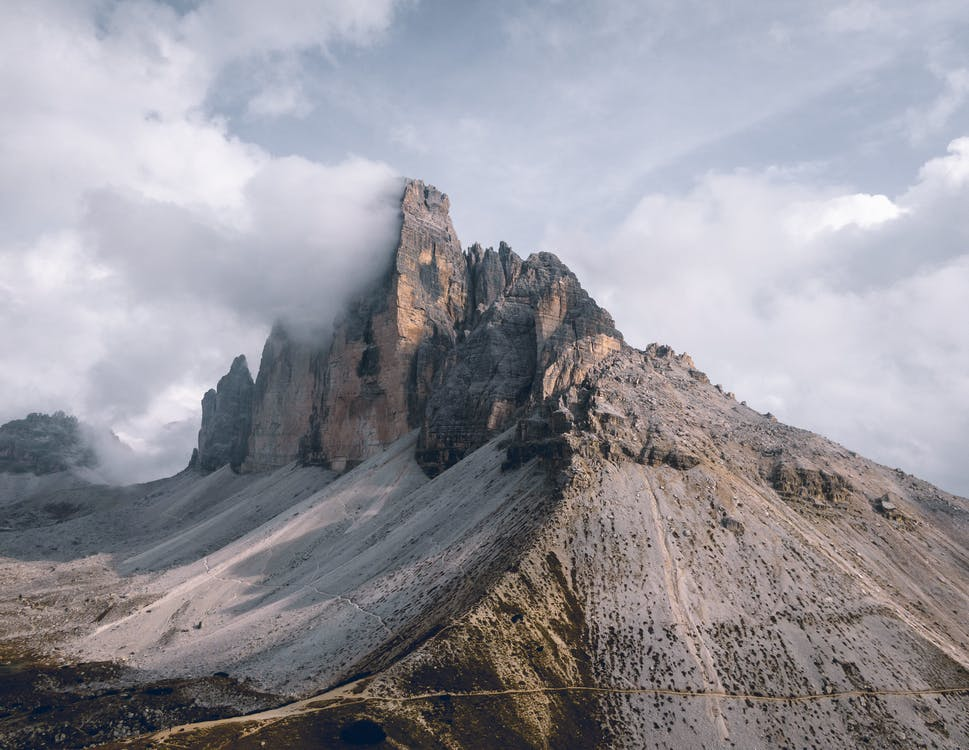 Photo Of Mountains Under Cloudy Sky