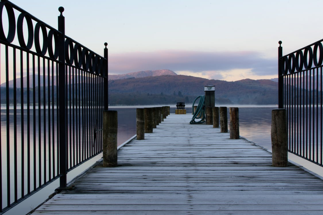 Gray Wooden Boat Dock on Body of Water