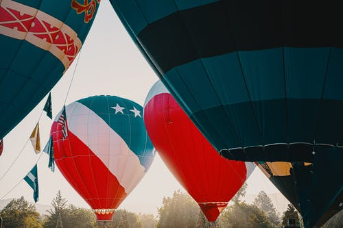 Inflated Multi-Colored Hot Air Balloons At Daylight