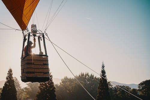 Man Riding in Hot Air Balloon