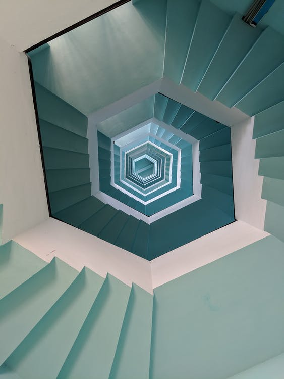 Empty Gray and White Concrete Spiral Stairs