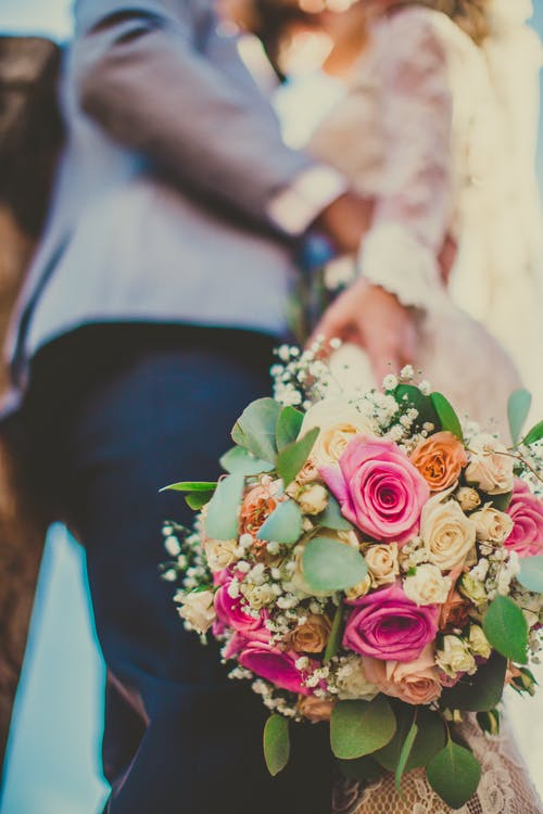 Close-up Of A Bouquet Of Pink and Beige Roses