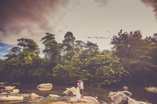 Couple Standing On A Rock