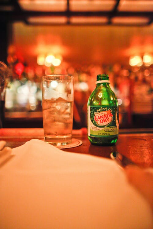 Canada Dry Bottle Beside A Drinking Glass