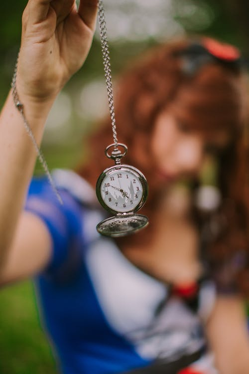 Woman Holding Pocket Watch