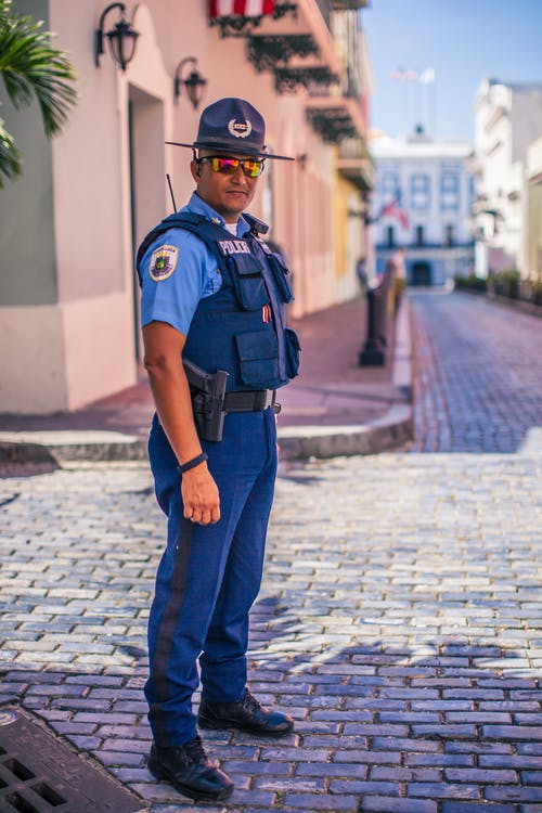 Standing Man In Uniform Wearing Bulletproof Vest
