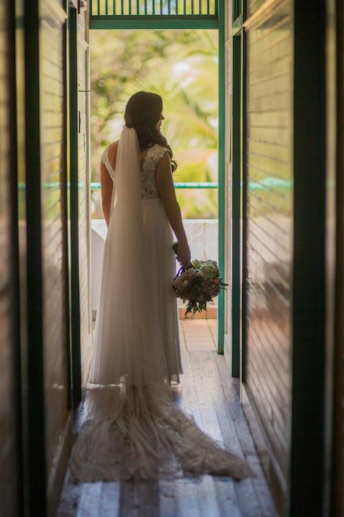 Woman Walking On Hallway