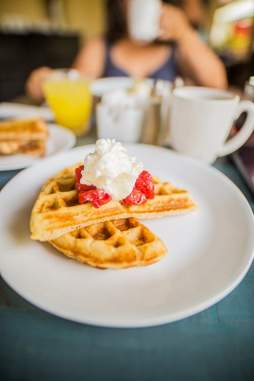 Two Waffle Slices On White Plate