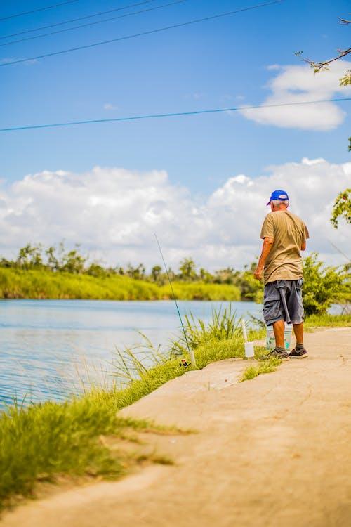 Man Standing Beside River
